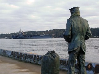 The Lone Sailor Welcomes the USS Ronald Reagan  CVN-76  to Bremerton 10 Jan 2012...Click For HR Photo